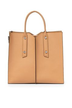 """Nothing says """"I got this"""" like a bag that sits by itself on the board room table.  Botkier Murray Hill Tote, $298; http://botkier.com"""