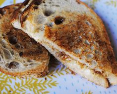 grilled cheese sandwich with sourdough bread, gruyere cheese, a lot of butter, and fig jam