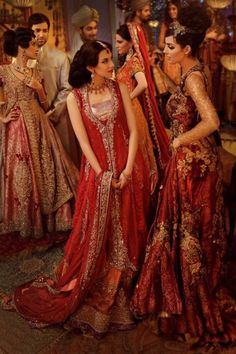 Indian fashion - beautiful.  In this photo lots of richly embroidered fabrics in shades of ruby.