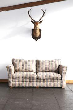 Simple Elegance. Uist Sofa and Stag's Head. #http://anta.co.uk/made-in-scotland/interiors #interiordesign #stag #sofa #anta
