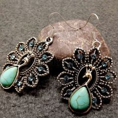 NWT Vintage Peacock Turquoise Drop Earrings Brand new gorgeous peacock turquoise drop earrings. Size is approx 4.2 cm x 3.3 cm. Ancient silver. One size. Feel free to ask me any questions. Great discount on bundles and thanks for stopping by!! Namaste  Jewelry Earrings