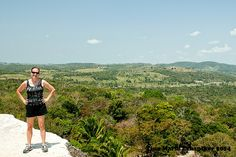 Standing on the top of Xunantunich, the Maya Pyramid in Cayo, Belize. Guatemala is in the distance.