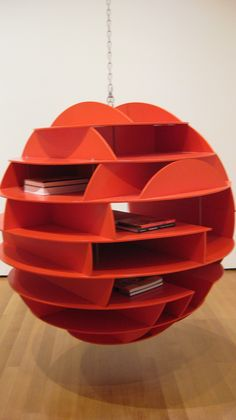 When you run out of wall space, you can always hang a sphere o' shelves from your ceiling.