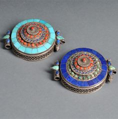 """Tibet   Two inlaid silver amulet boxes, Gau; circular, each with filigree decorations and inset turquoise, lapis lazuli, and agate stones, stamped """"925"""" on base   20th century   Est. 400 - 600$ ~ (Apr 13)"""