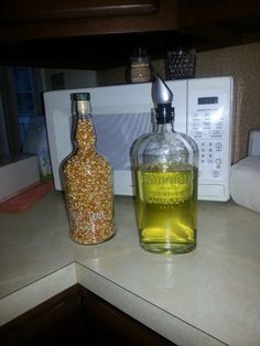 What to do with your empty whiskey bottles? Add pop corn, cooking oil with a pour top, whatever you have. I have so many, I had to do something, or the trash men would think I'm an alcoholic!