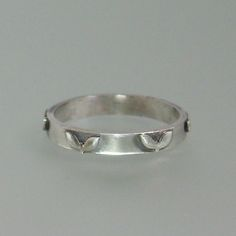 Sterling silver wedding band adorned with heart leaves by Kryzia Kreations  http://www.kryziakreationsstudio.com/products/sterling-silver-wedding-ring-with-heart-leaves  $150.00
