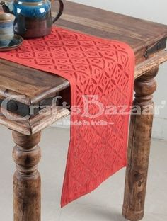 Setting a sophisticated table is important for the perfect night when you're hosting a dinner party. Impress your guests with your fashionable taste with the help of Indian traditional weaving handloom of Rajasthani Applique work. This red table runners are of purely cotton and will last through many, many dinner parties or even daily use for dining.It is designed with barfi symbols.Handmade, Indian Luxury embroidered furnishings for Living Room, Dining Room, Bedrooms, Plagrooms and Study...