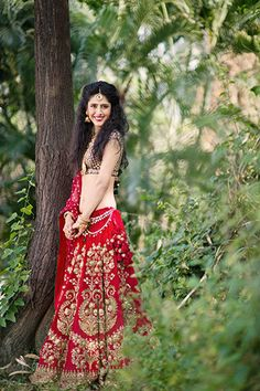 Sabyasachi red bridal wedding lehenga with gold zardozi embroidery styled by Bridelan
