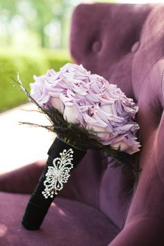 beautiful roses for a purple wedding: Black velvet bouquet wrap with brooch. photo by Ashley Biess