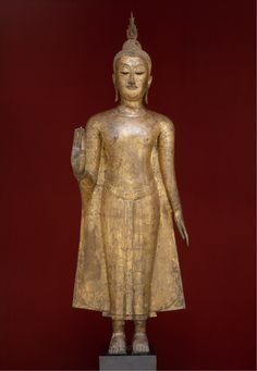 Features abhaya mudra: bestowing fearlessness flame on crown clinging robe both shoulders covered Date: 15th century Culture: Thailand Medium: gilt bronze Dimensions: H 61 1/2in (156.2cm) Full size…