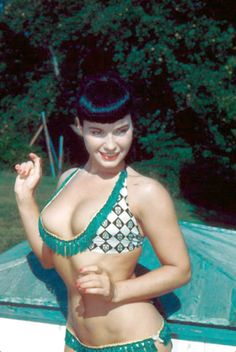 Bettie Page... I love the shape of this swim suit top!