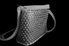 White handmade purse / bag, using aluminum recycled soda can tabs and crochet.    - Closed with zip    - Long handle    - Lined inside with cloth