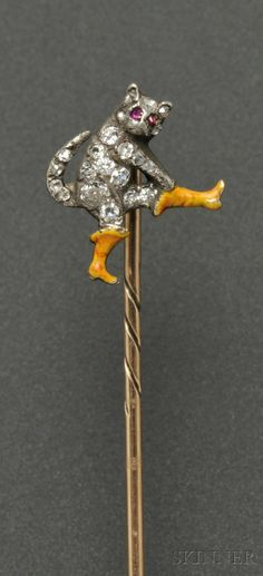 Antique enamel and diamond stickpin, the gentleman cat with old European, single-cut and rose-cut diamond melee body and ruby eyes, pulling on a pair of enamel boots, silver and gold mount. Cat Jewelry, Animal Jewelry, Jewelry Art, Jewelery, Fine Jewelry, Jewelry Design, Victorian Jewelry, Antique Jewelry, Vintage Jewelry