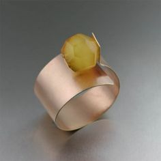 Contemporary Bronze Bangle with Butterscotch Amber - Go bold this season! Put the dainty jewelry away and try this stunning Contemporary Bronze Bangle Bracelet. This glamorous bangle shows off a bold faceted genuine Baltic Butterscotch Amber focal bead set against a matte finish. Bangle bracelets are the perfect way to add individuality to any ensemble for any occasion.- JOHN S. BRANA-USA