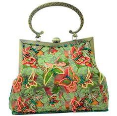 A flight of butterflies bag  http://www.enchantedivygifts.co.uk/finishing-touches-c1/handbags-evening-bags-purses-c29/faye-london-vintage-style-green-beaded-butterfly-tapestry-evening-bag-p515