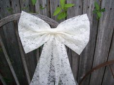 Big, Beautiful Ivory Lace Pew Bow. This elegant lace bow is approximately 12 inches wide and the bow is approximately 7.5 inches tall. From the top of