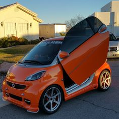 This fine, fierce orange smart is ready to take on the world.  Photo by @dustin_allblue #LamboDoors #Auto #Car #smart #smartcar