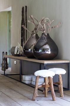 love the large vases and stool