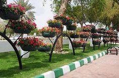Recycle old tires as planters in public space... More
