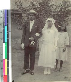 Malagasy bride and groom with their bridesmaid, Antsirabe, Madagascar, ca.1923 :: International Mission Photography Archive, ca.1860-ca.1960