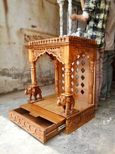 Get Connected to the Spiritual World & Find Peace with Aarsun Highly Customizable Wooden Temple & Prayer Units made in Sheesham & Teak Wood. Wooden Temple For Home, Temple Design For Home, Home Temple, Wooden Door Design, Wooden Art, Wooden Staircase Railing, Modern Reception Desk, Mandir Design, Pooja Room Door Design