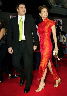 See more pics of celebrities in Chinese dresses: Oriental celebs in Chinese dresses Western Celebrities in Chinese Dresses Paris Hilton in Chinese Dress Paris H Chinese Dress Cheongsam, Red Chinese Dress, Chinese Style, Chinese Dresses, Kelly Preston, John Travolta, Chinese Clothing, China, Ao Dai