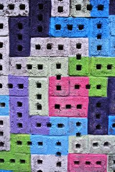 Painted cinder blocks - can be used for planters -- for the kids flower garden