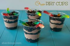 2 cups cold milk 1 package (4 oz) chocolate instant pudding 1 – 8 oz container whipped topping, thawed 1 package (16 0z) Oreos (crushed into crumbs) Gummy Worms 10 plastic cups (8 oz. size)