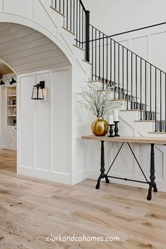 In this entry foyer, metal railing complements the black and white stair runner and wood flooring. In this entry foyer, metal railing complements the black and white stair runner . Foyer Staircase, White Staircase, Entryway Stairs, Staircase Remodel, House Stairs, Entry Foyer, Staircase Design, Black Stair Railing, Stairway Decorating