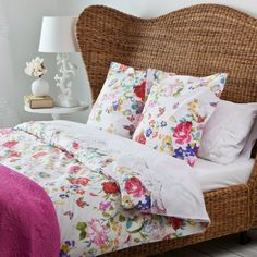 (via Cozy Summer Bedding with Flower Pattern on Rattan Bed)