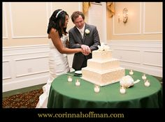 www.corinnahoffman.com White, decorative wedding cake being cut by the bride and groom at River House St. Augustine, Florida.