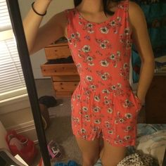 Coral and Flower Romper with Pockets Coral and Flower Romper with Pockets. In great condition, only been worn a couple times! Open back with buttons at top, size S Frenchi Dresses
