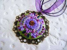 Polymer clay pendant by danielle
