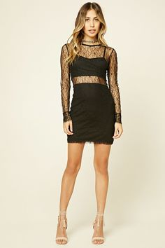 A knit mini dress featuring a sheer floral lace overlay, long sleeves with eyelash lace trim, round neckline, and a concealed back zipper.