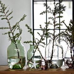 House Doctor – Keep things simple by using individual branches and clusters of decorations