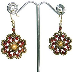 Looking for beaded jewelry ideas? These Beaded Flower Earrings are a simple and quick project you can make in an evening and wear to work the next day. Weave together crimson, bronze, and gold beads to create a fabulous beaded flower pattern.