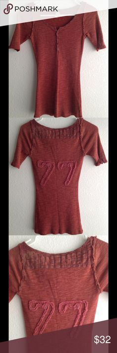 NWOT Free People We The Free top XSMALL color red New without tags never wore no flaws perfect new condition Free People We The Free top size XS color washed red really pretty details..... Reasonable offers welcome Free People Tops Tees - Short Sleeve