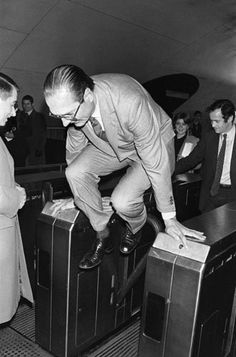 Jacques Chirac dodging a turnstile in the Paris subway on Dec 5, 1980, station Auber. He was then Mayor of Paris