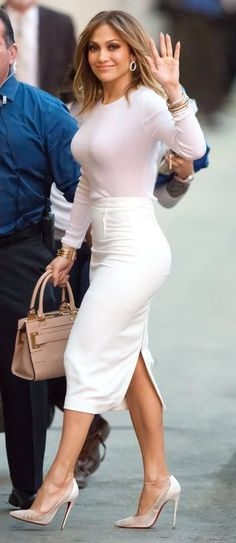 Jennifer Lopez in a pink top, white pencil skirt and Christian Louboutin heels