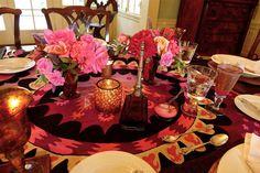 Garden roses & vintage Suzani tablecloth for a Moroccan dinner.