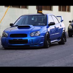 my dream car is a Subaru WRX Sti in a Subaru blue with dark grey gunsmoke rims and the not flat spoiler and a nice hood scoop, although recently I've been considering a white Subaru with blue rims Wrx Sti, Tuner Cars, Dream Cars, My Dream Car, Jdm, Amazing Cars, Exotic Cars, Sexy Cars, Cars Motorcycles