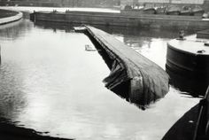 "Caption: ""Sunken British Waterways boat at Little Venice on the Paddington Arm of the Grand Union Canal"""