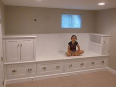 finished basement bench seating storage | Built-in bench that features five drawers and plenty of storage space ...