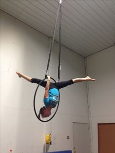 Aerial hoop, ngl am proud to say I have done this move. awesome pic