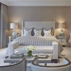 neutral master bedroom decor ideas in ivory and grayish blue with an end of the bed upholstered bench in a co ordinating colour soft luminous bedroom