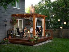 Outdoors: Exquisite Wooden Deck Ideas For A Small Yard With Curtain And The Flowers In The Corners Of The Deck, Sloped Deck Pictures, Backyard Deck Designs ~ WHCHomes