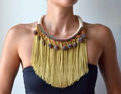 This is a necklace that is part of the new PROPS Ethnic collection ! It is made of 10mm rope, 18cm fringe, bronze colorful pom pom and magnet clasp.  Neckline length : 52cm (20.50 in) Make it yours or turn it into a gift! Njoy Props fashion style!!  *Because each item is made upon order please allow 3-5days before shipment