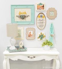 Boutique-style décor at the touch of a hot glue gun? You bet. Just adhere ready–made embellishments to everyday items, and say hello to easy-breezy home décor. We tried them on wooden rounds, plaques and frames for this gallery wall– and the finished look was nothing short of a DIY dream come true.