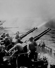 """Task Force 58 raid on Japan. 40mm guns firing aboard USS HORNET on 16 February 1945, as the carrier's planes were raiding Tokyo."" Lt. Comdr. Charles Kerlee, February 1945."