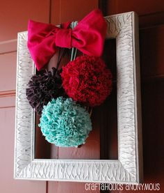 Turn old shirts into pom poms! Learn how to make pretty poms using t-shirt yarn. Perfect for baby rooms, weddings, parties, decorating. t-shirt pom poms